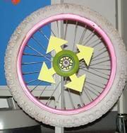 Small white wheel rolls the display around