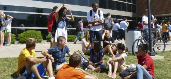 students lounging on lawn outside RSC