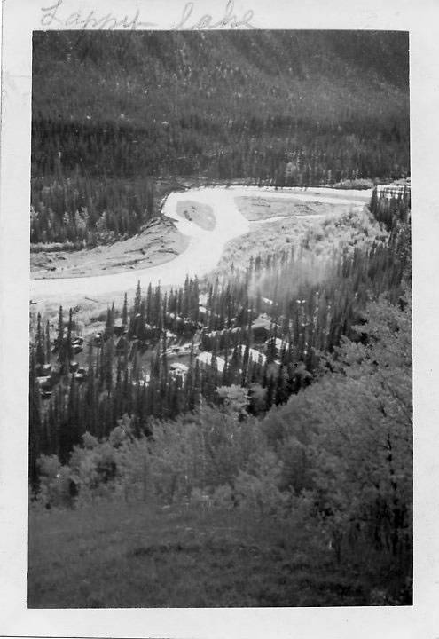 B&W, Pipeline runs along a river.