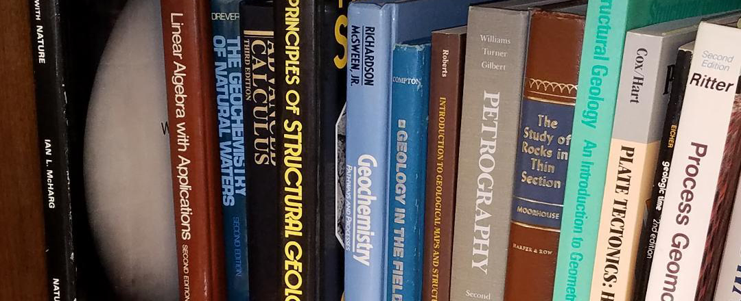 A row of books on a bookshelf. Edited from USGS at https://www.usgs.gov/media/images/a-row-books-a-bookshelf