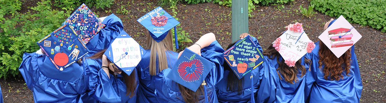 MCC graduation - photo of students with inspirational quotes on their mortar boards