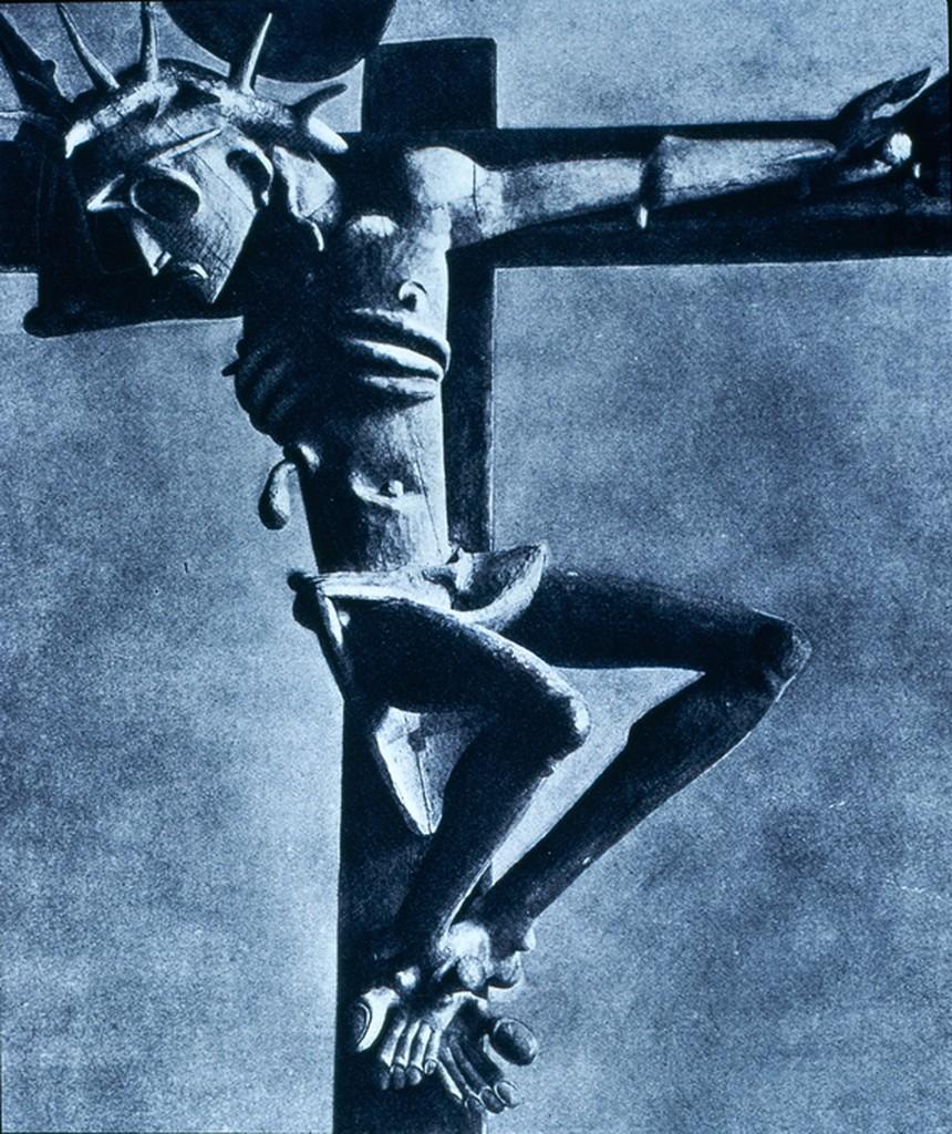 sculpture of figure on a cross
