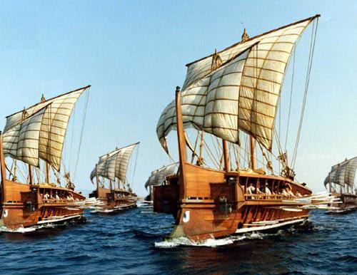 replicas of several ancient greek trireme galleysunder sail
