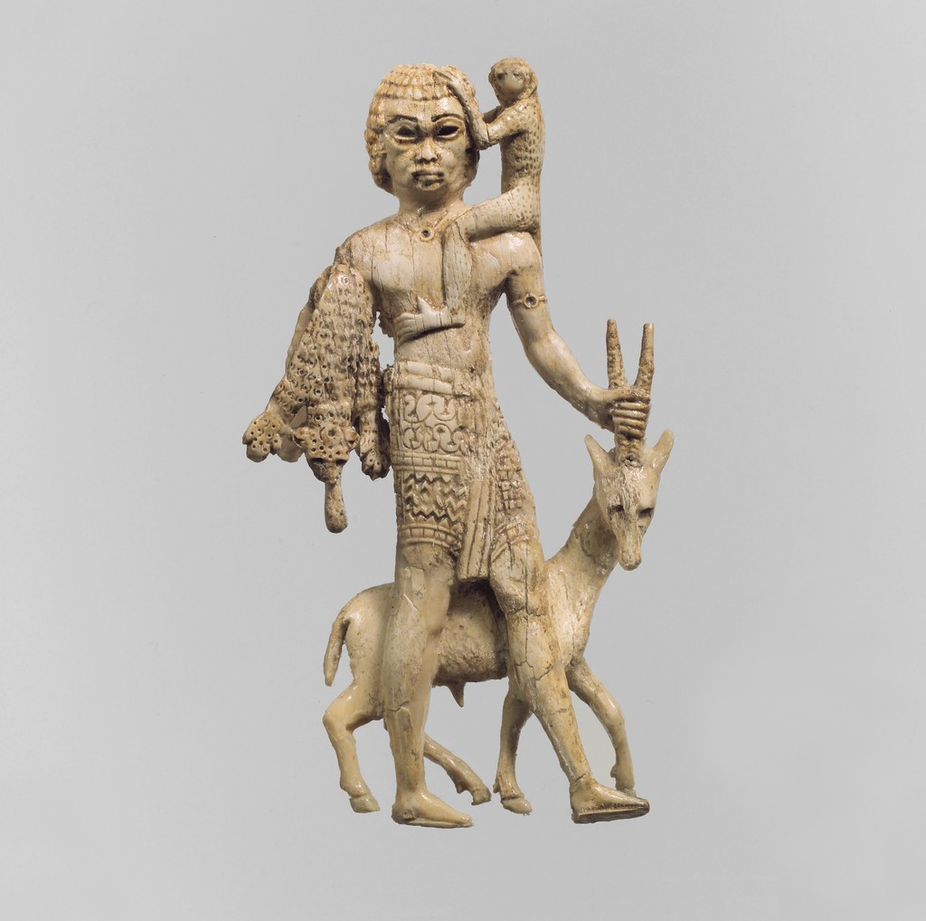 ancient figurine with monkey and antelope