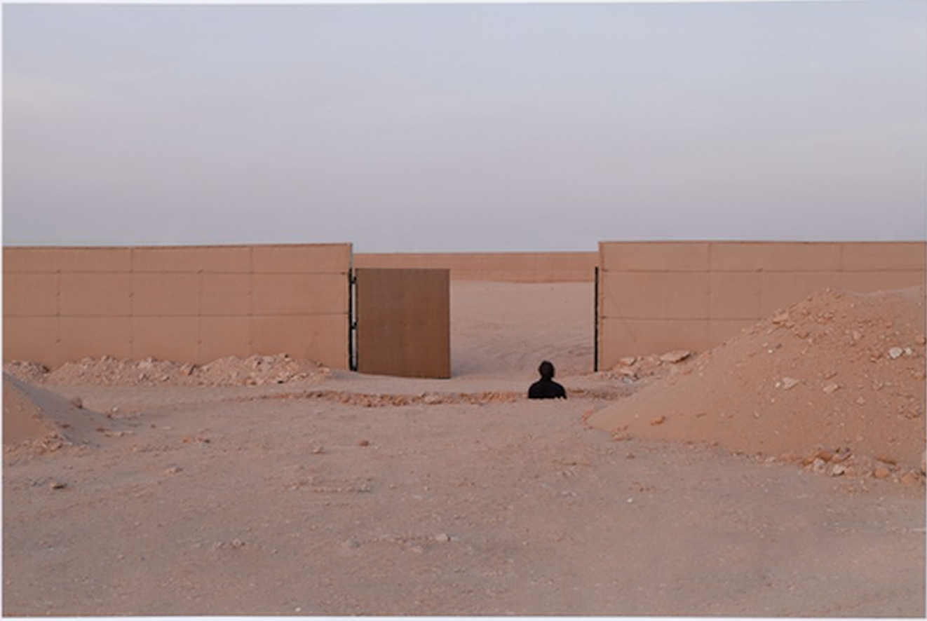 desert with wall and partial figure