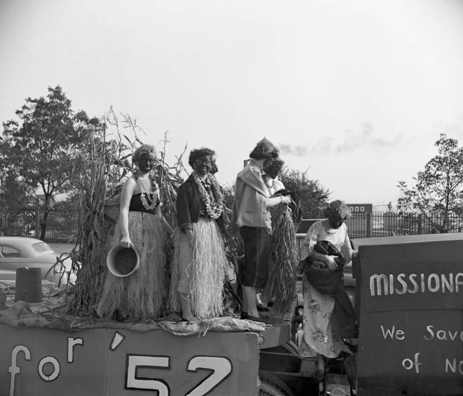 Black & white photo of 5 women in blackface.