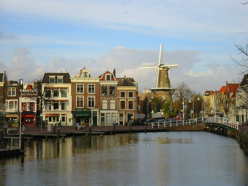 Leiden, Netherlands picture of canal, buildings, and windmill