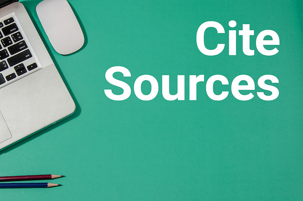 """Cite Sources."" Laptop, mouse, and pencils."