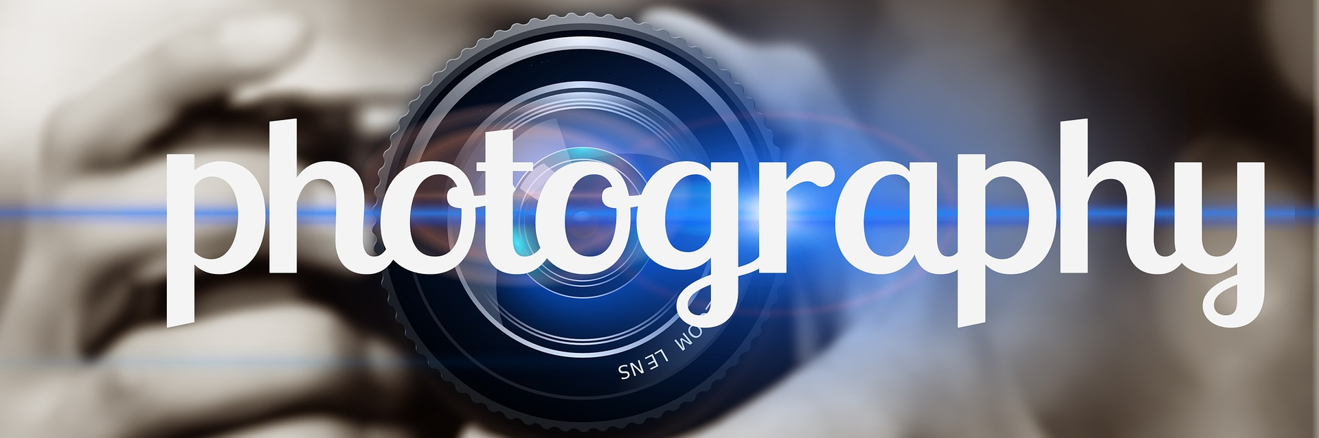 Photography written in front of a camera lens