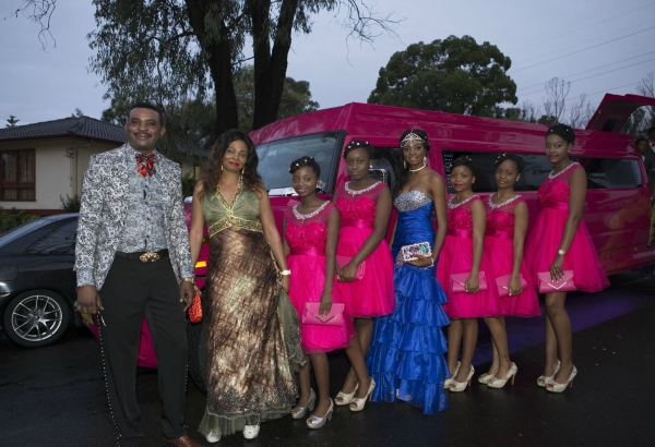 Mother and father Isaac Kisimba and Justine Nydal pose for a photo with their daughter Nadine Muyambo and the official Sweet 16th official friends party, Doonside, N.S.W., 2 May 2015 from Culturally and linguistically diverse communities, Sydney, 2014-2015 / photographed by Louise Whelan