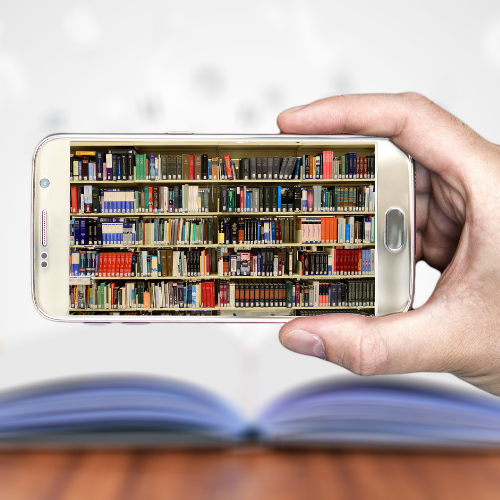cellphone with a bookcase loaded with books on the screen
