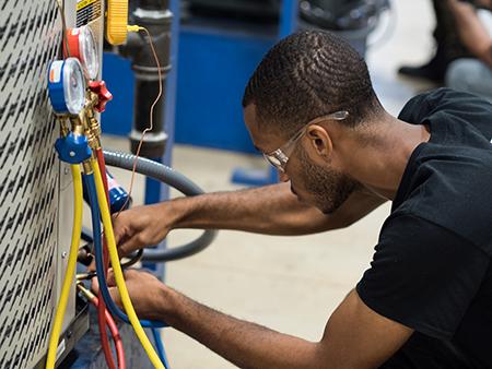 Man repairing HVAC unit