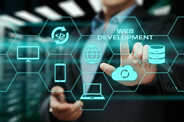 Information and web technologies picture with green hexagons that has web symbols inside each one. There is a male in a suit in the background touching the hexagons
