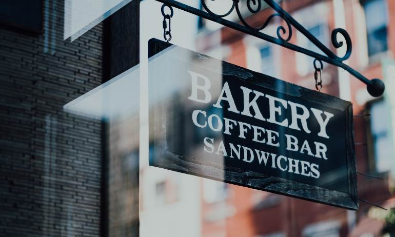small business resources picture of a bakery coffee bar sandwiches sign written in white on a black background