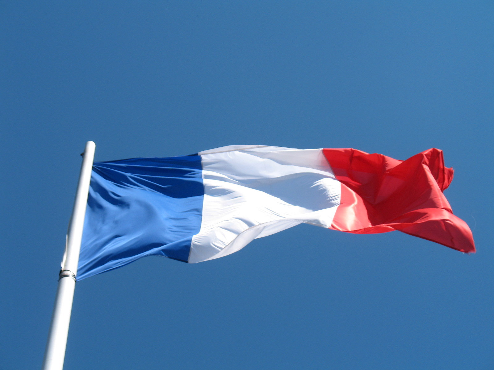Image of the French Flag on a Flag Pole