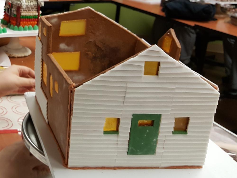 2016 Gingerbread White Siding House