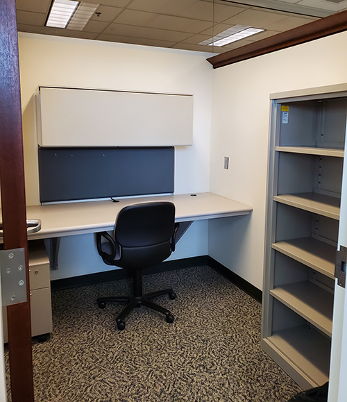 library office for faculty and graduate students with desk, chair, and shelves