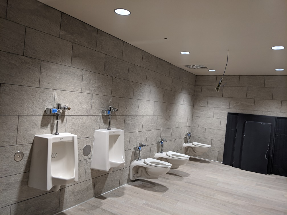 installation of toilets and partitons in library restroom