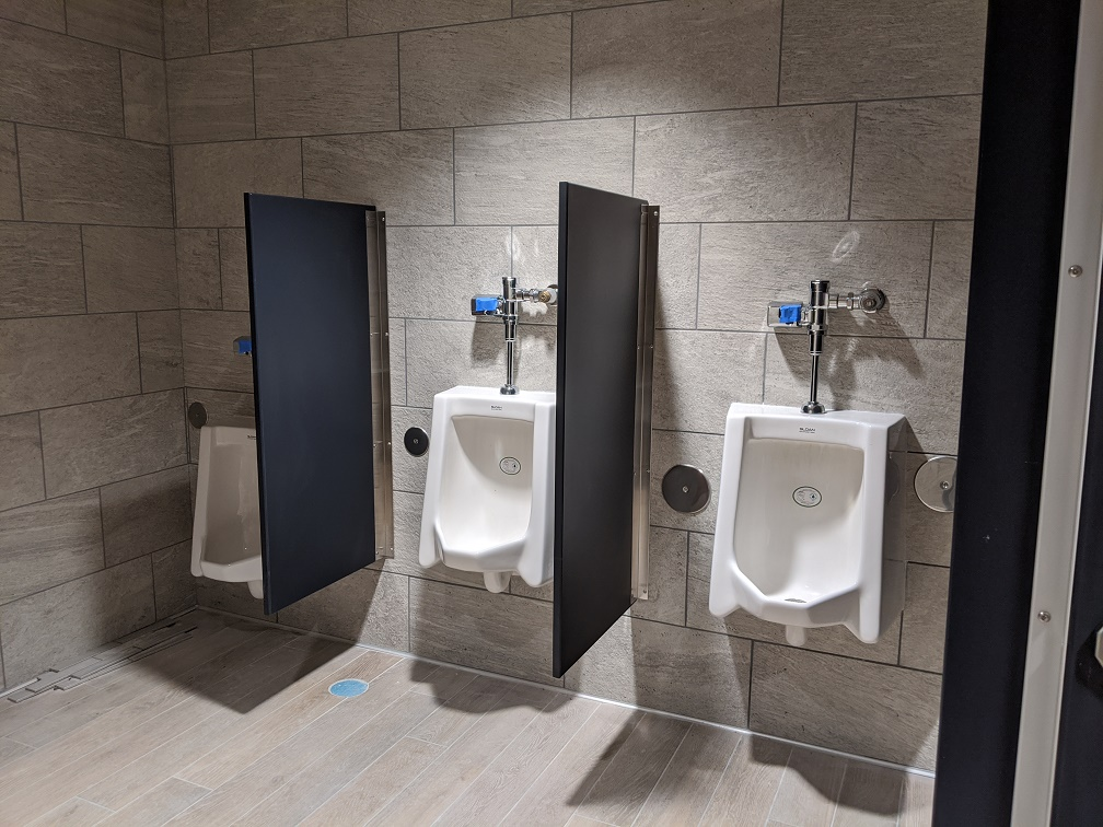 New gray partitions and urinals in library restroom