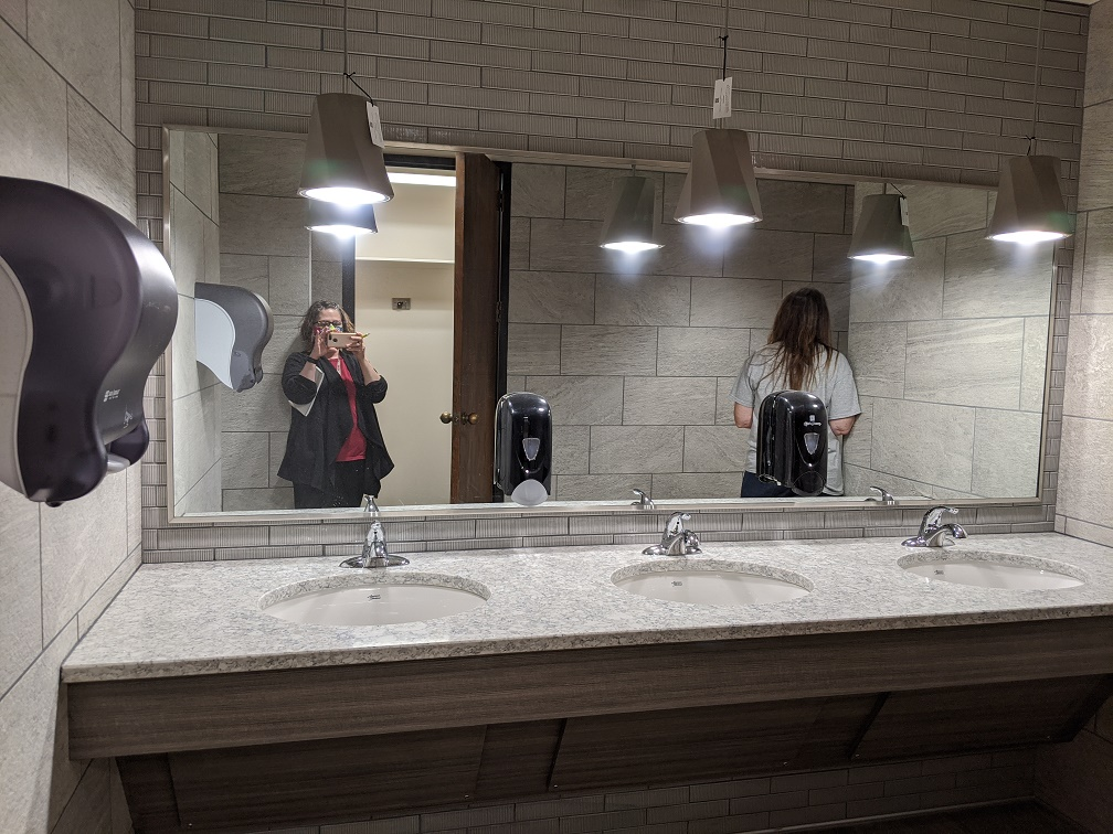 Mirror, counter top, and sinks in restroom