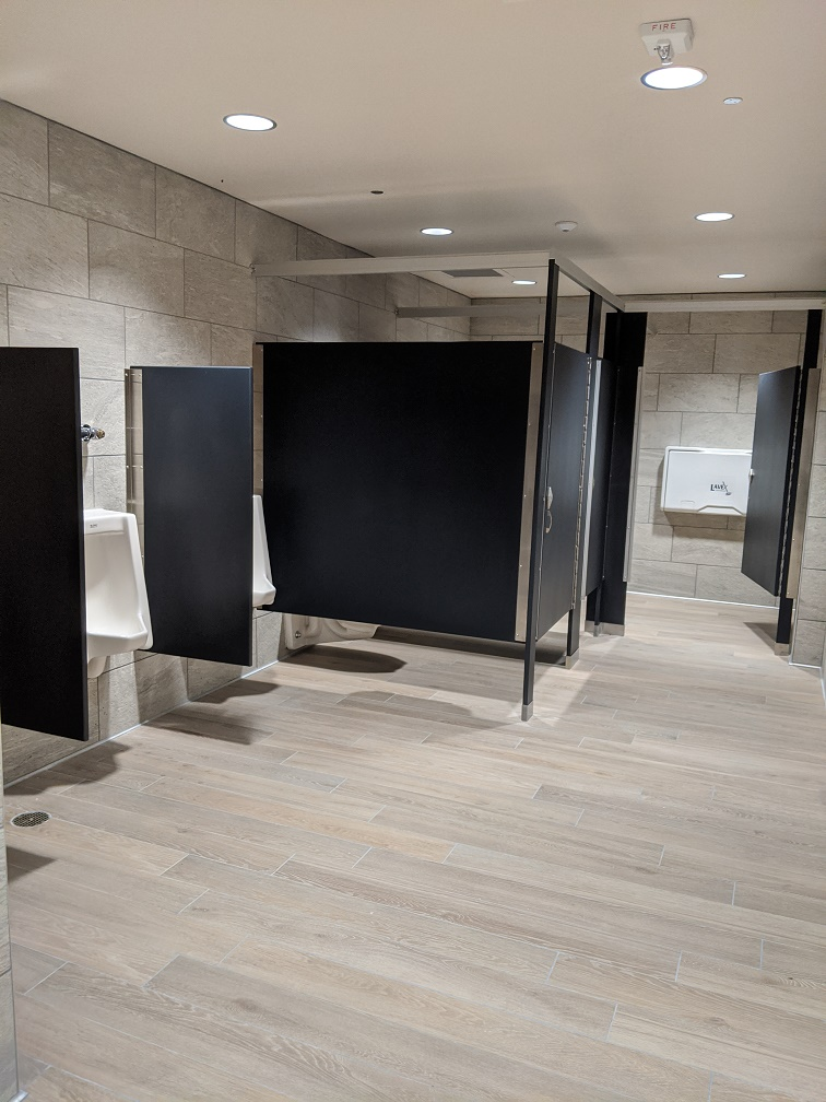 restroom stalls with changing table