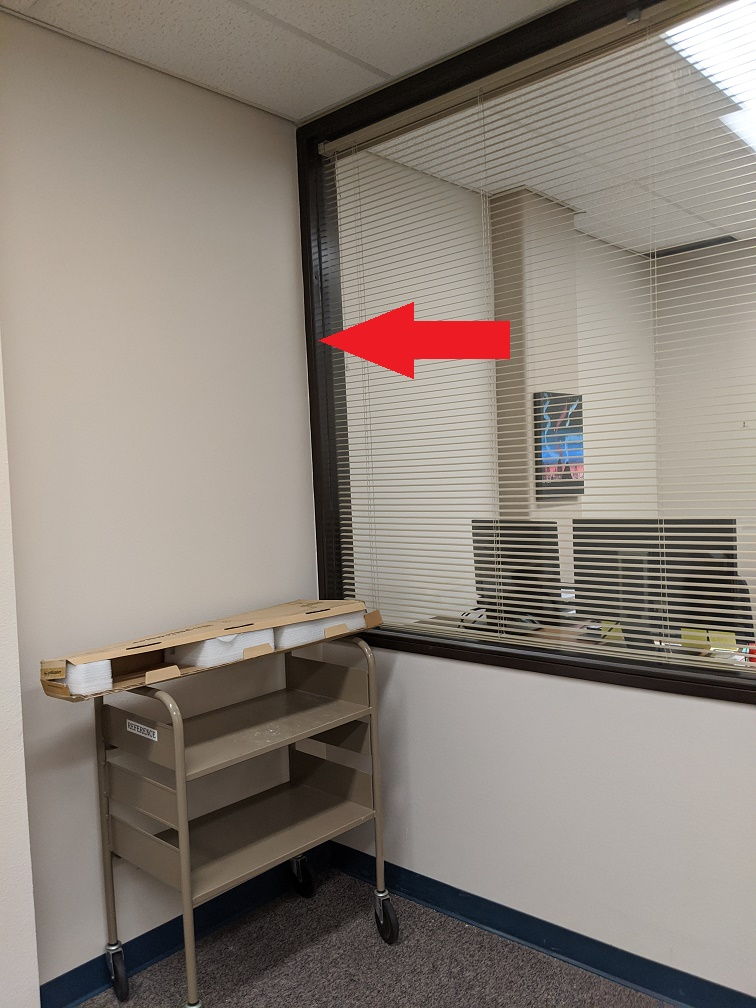 Office suite with red arrow pointing at new wall