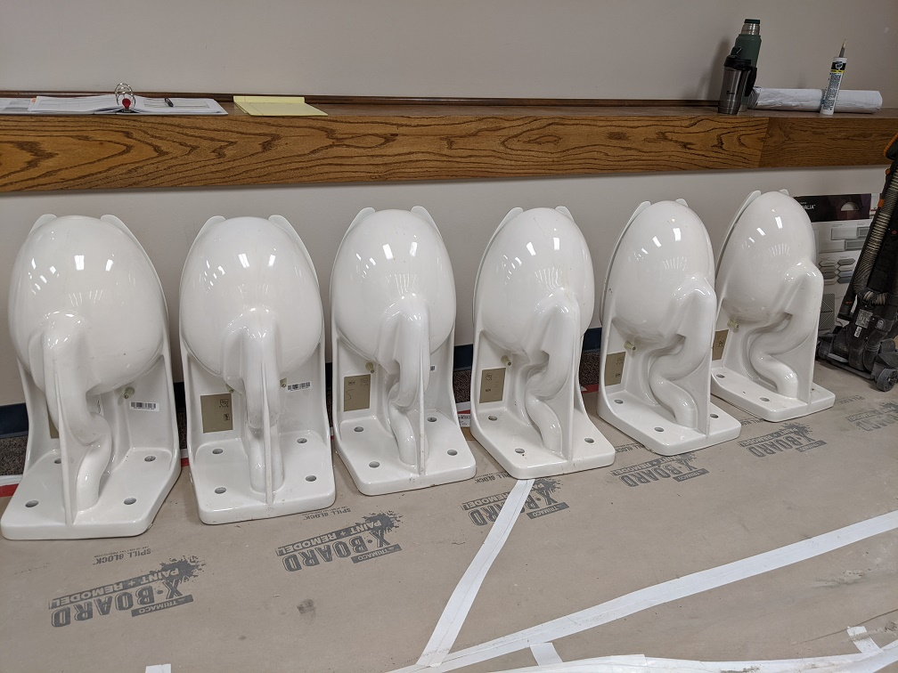 row of toilets waiting to be installed