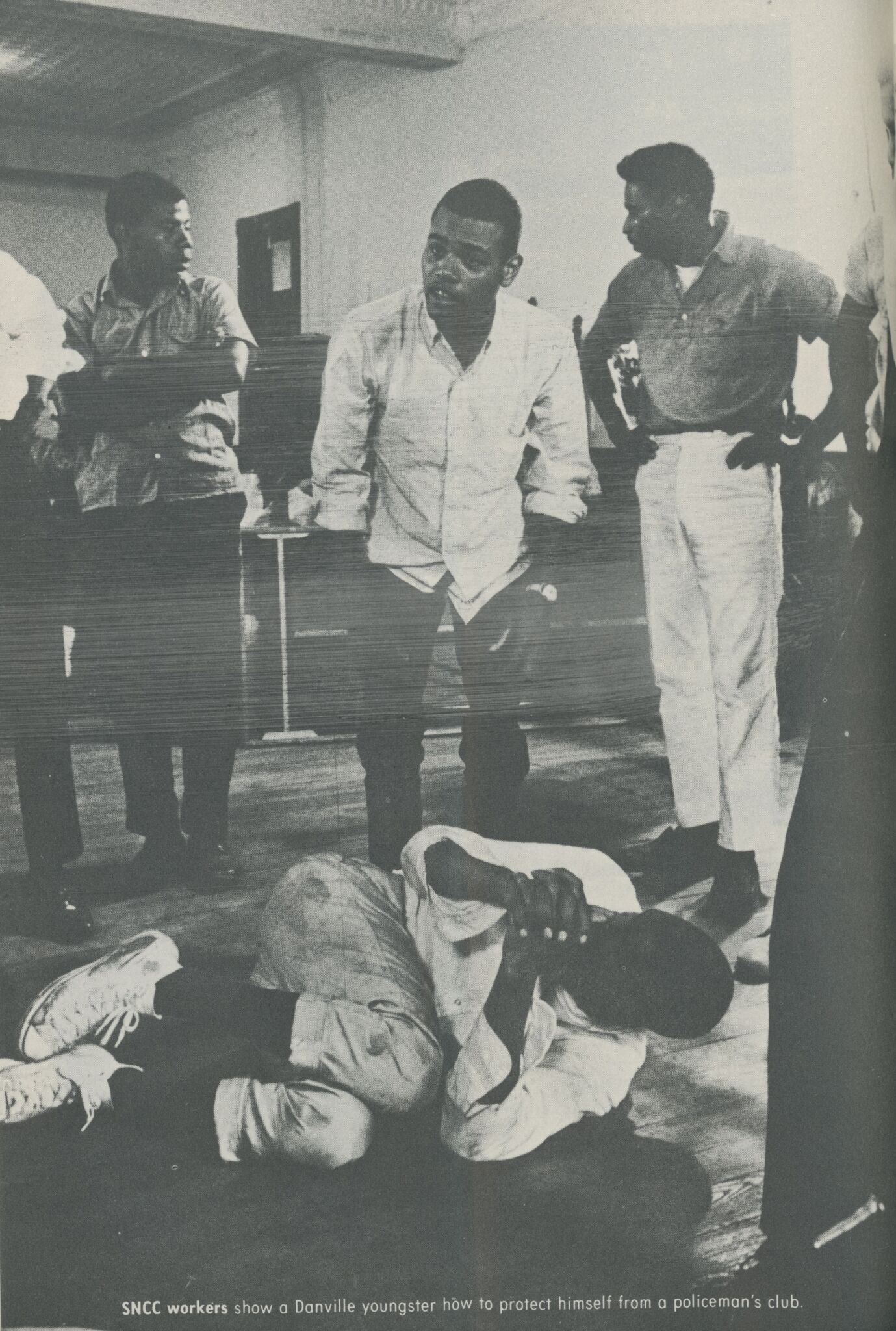 Photograph of nonresistance protest training from booklet on Danville by Dorothy Miller and Danny Lyon.  Published by the Student Nonviolent Coordinating Committee. Atlanta:  August 1963.