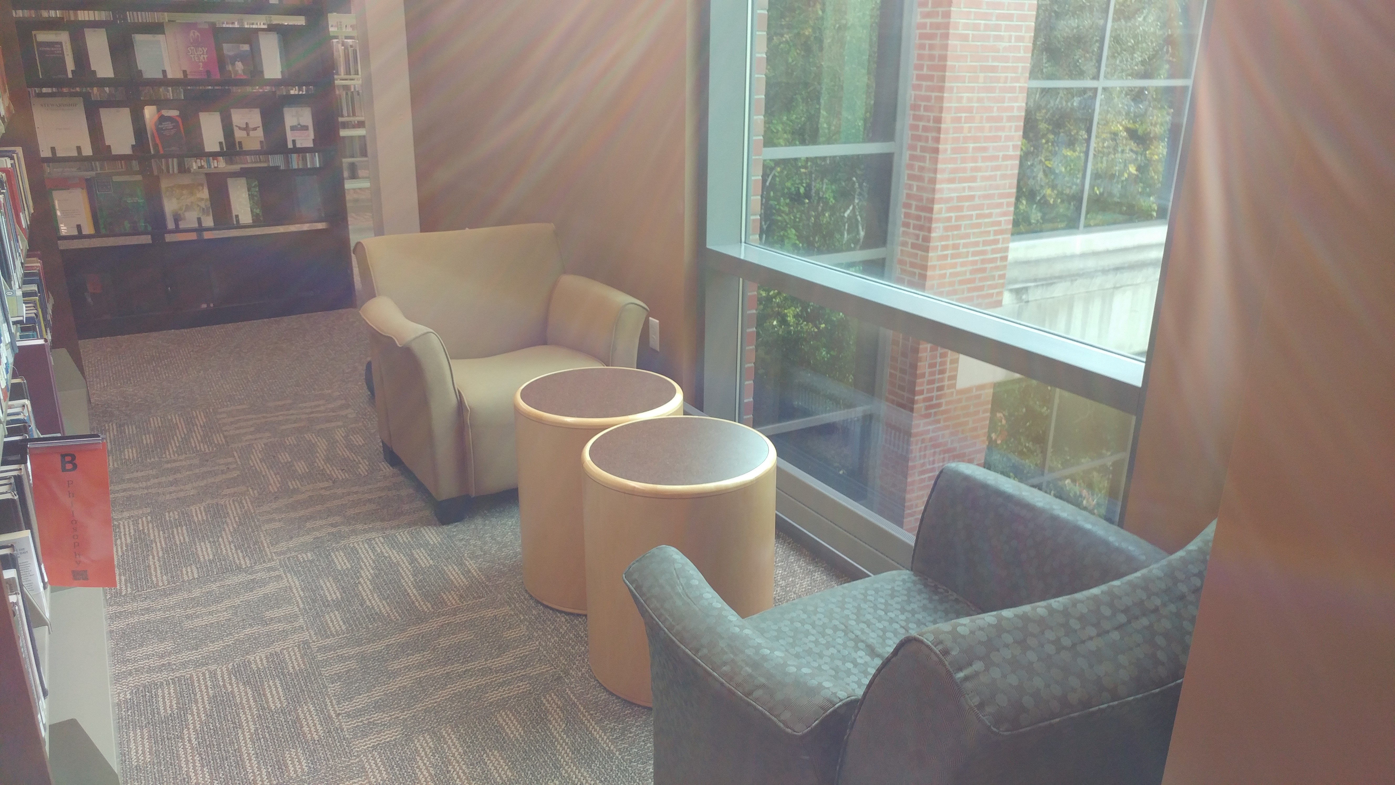 Chairs by window on second floor of library