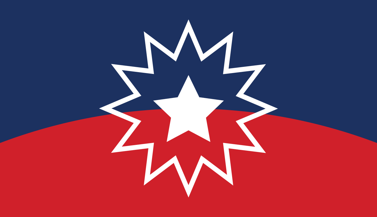 The Juneteenth flag, featuring a white star and starburst over a dark blue ground and a curved red horizon