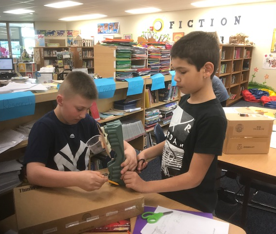 Boys using makerspace materials