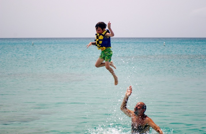 Buzz playing with his son in the ocean