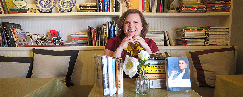 Laurel Tacoma in her study, surrounded by books.