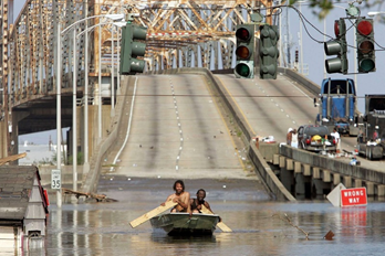 Photograph of people boating on hurricane Katrina floodwaters in New Orleans