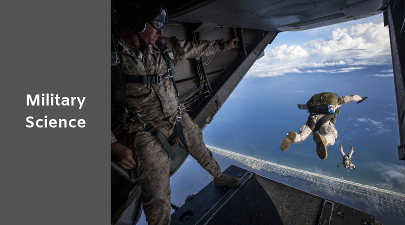 photo of servicemen jumping out of a helicopter