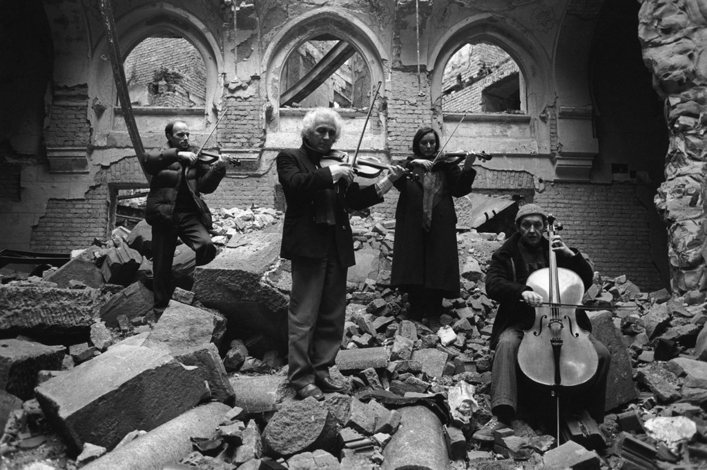 Orchestra playing in the ruins of a building destroyed in the war