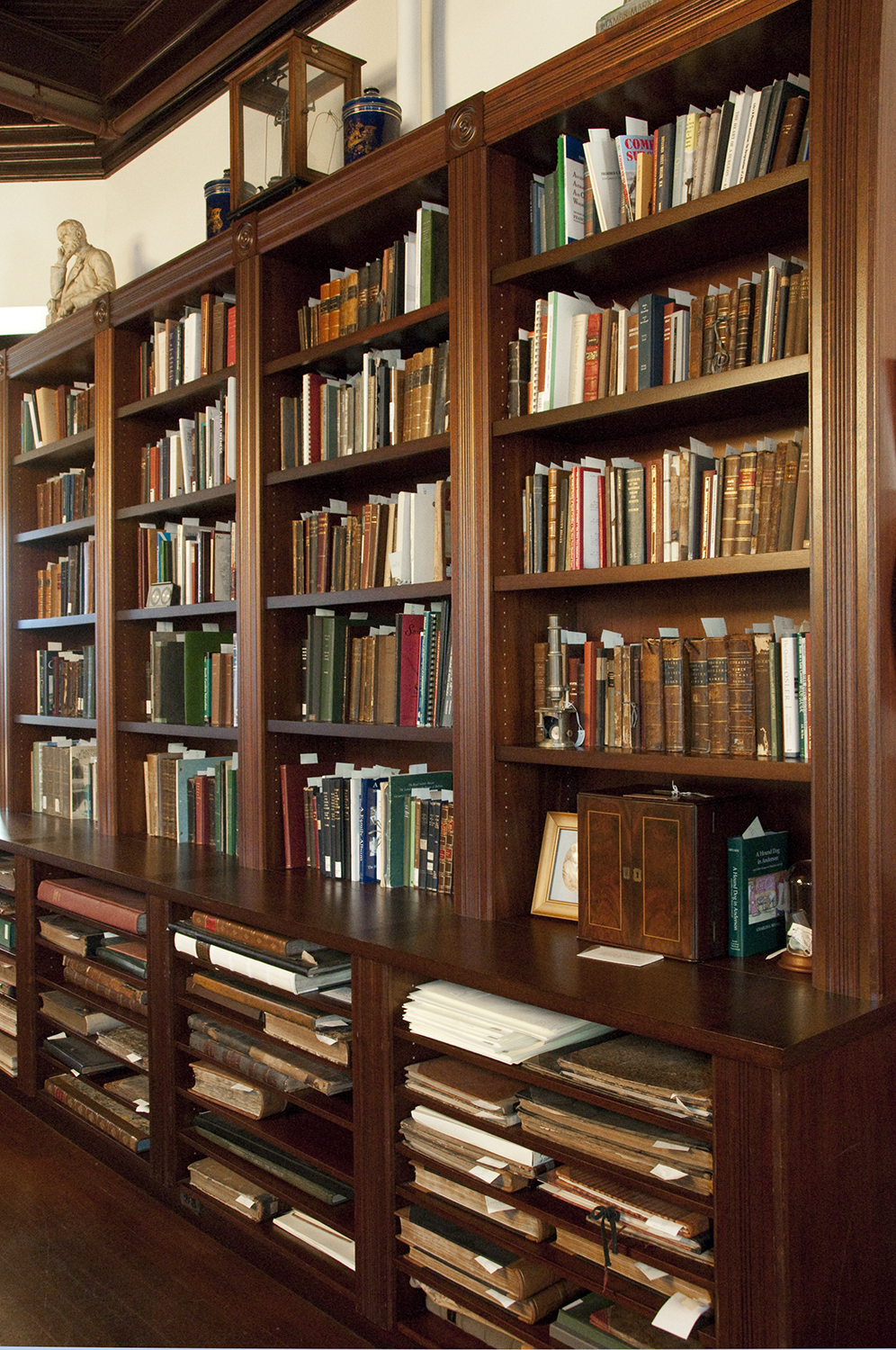 Photograph of the first floor bookcase of the Waring, the Waring's holdings include over 12,000 books