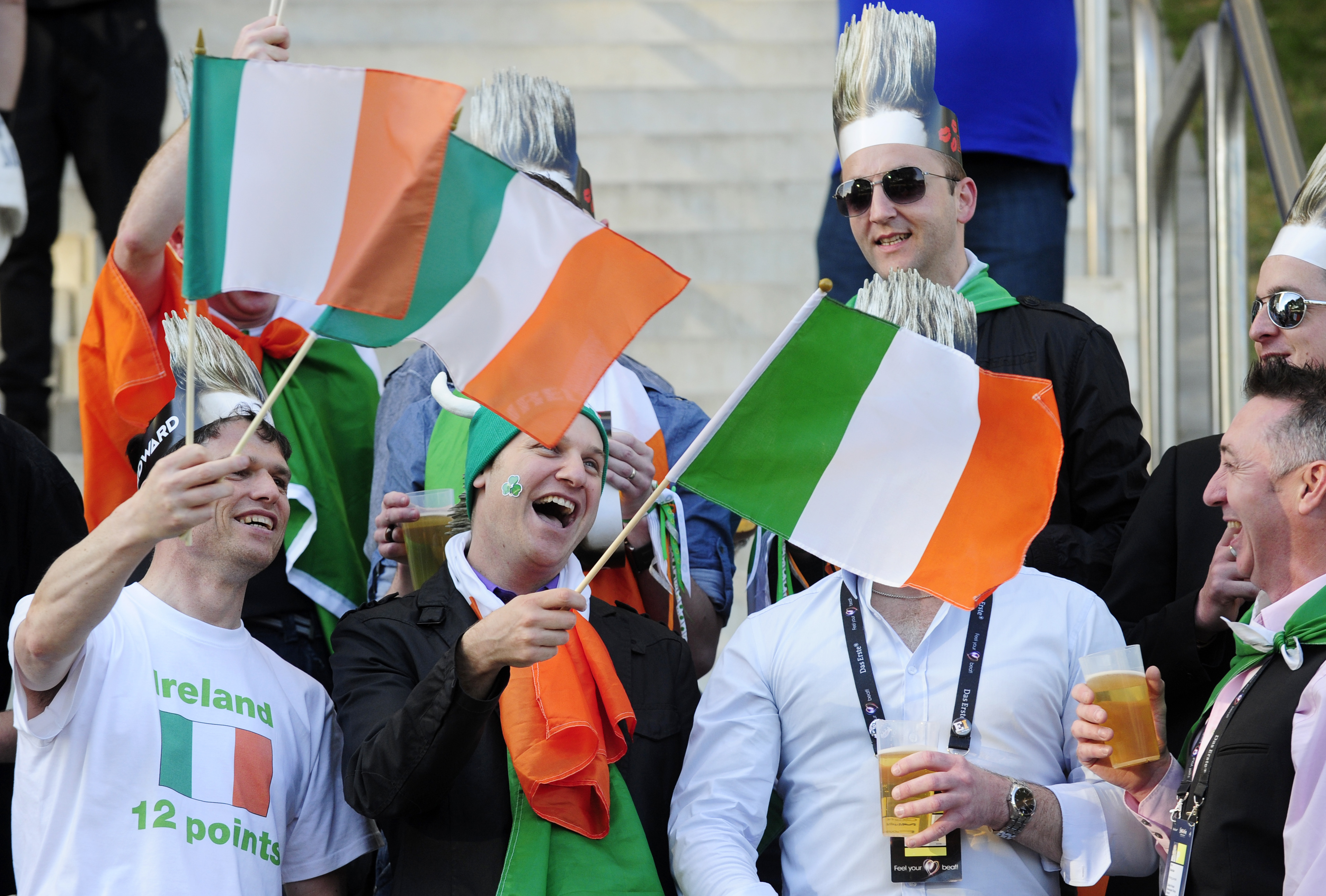 reland Supporters Cheer with their National Flags