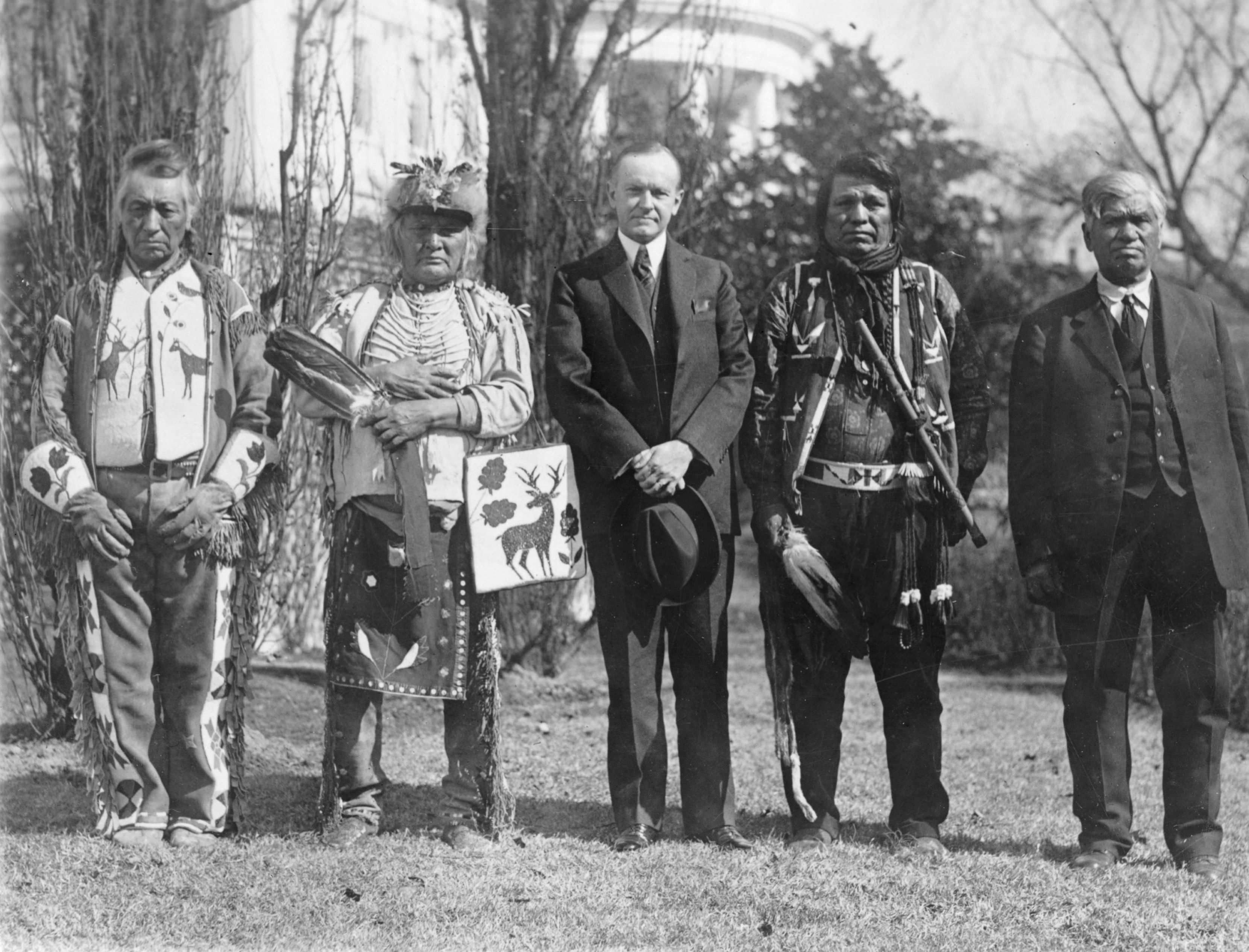 U.S. President Calvin Coolidge with four Osage Indians after Coolidge signed the bill granting Indians full citizenship