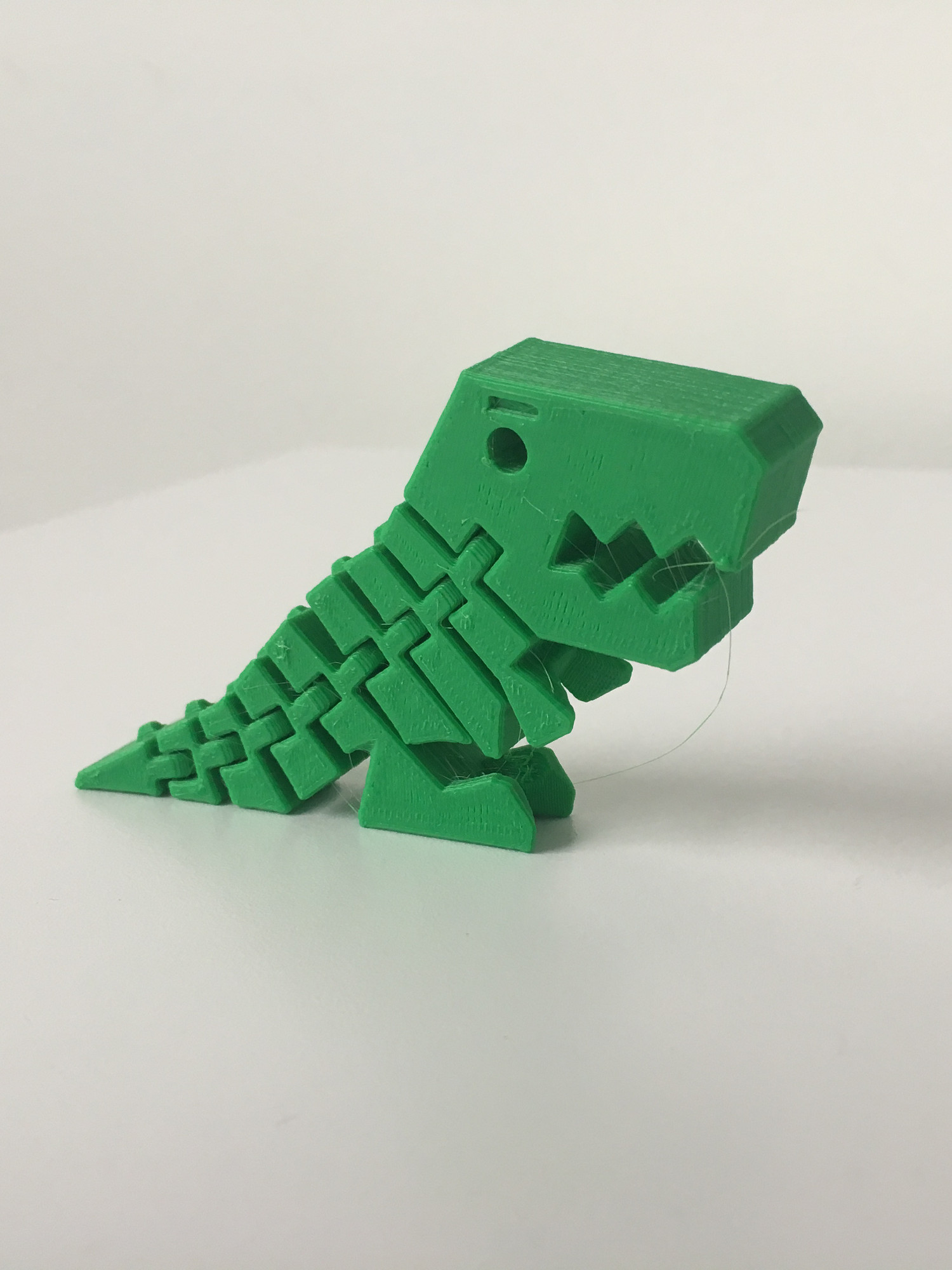 Green 3D printed hinged t-rex toy