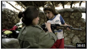 """Video still from """"Images of Conflict"""", woman and girl with gun"""