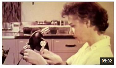 Video still of scientist
