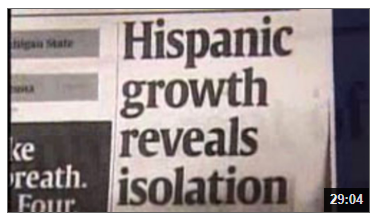 Video still of newspaper headline from the Blending of Culture: Latino Influence on America