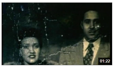 """Video still from """"The Way of All Flesh"""" showing photo of Henrietta Lacks and husband"""