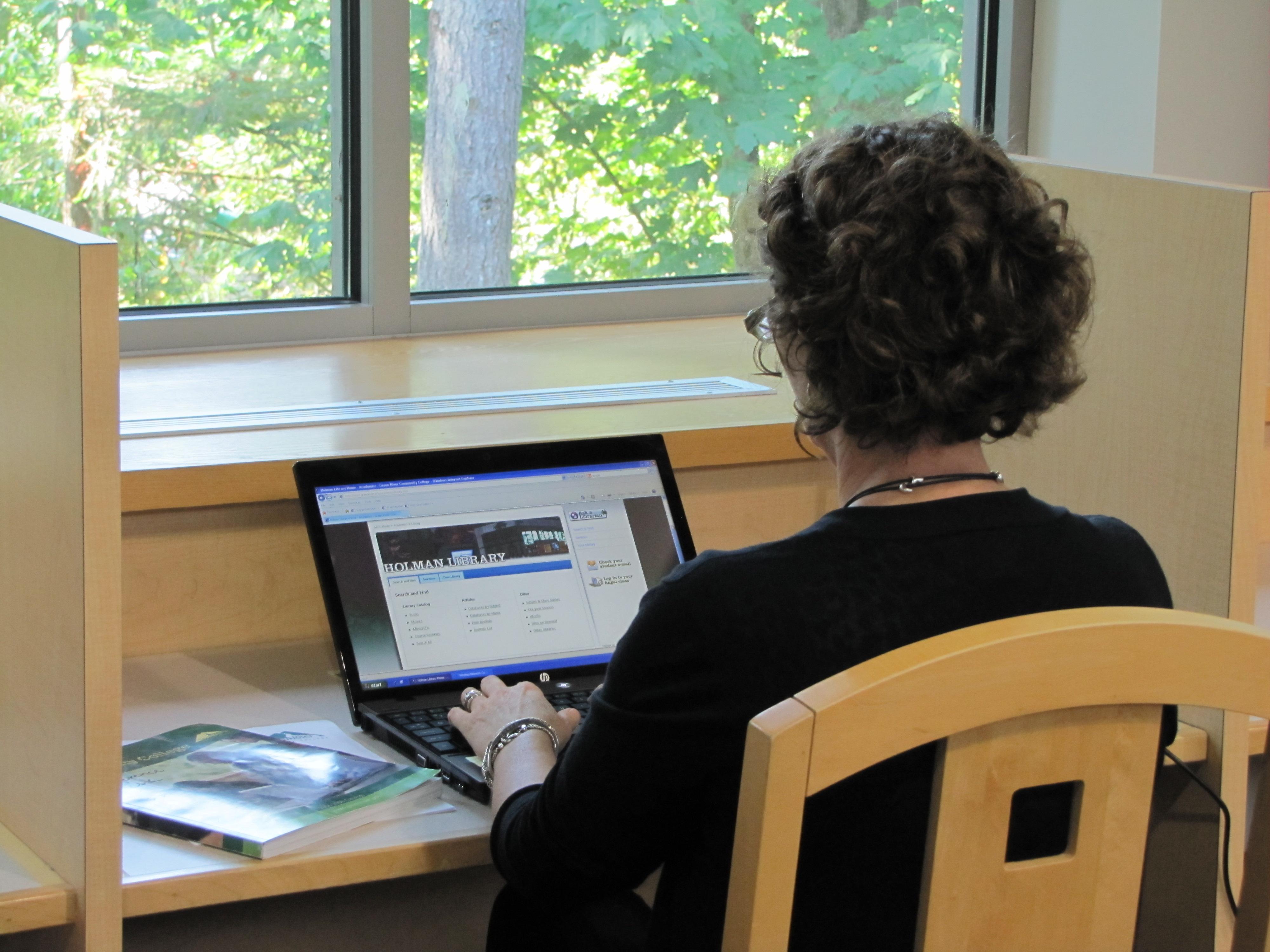 Laptop user at Holman Library
