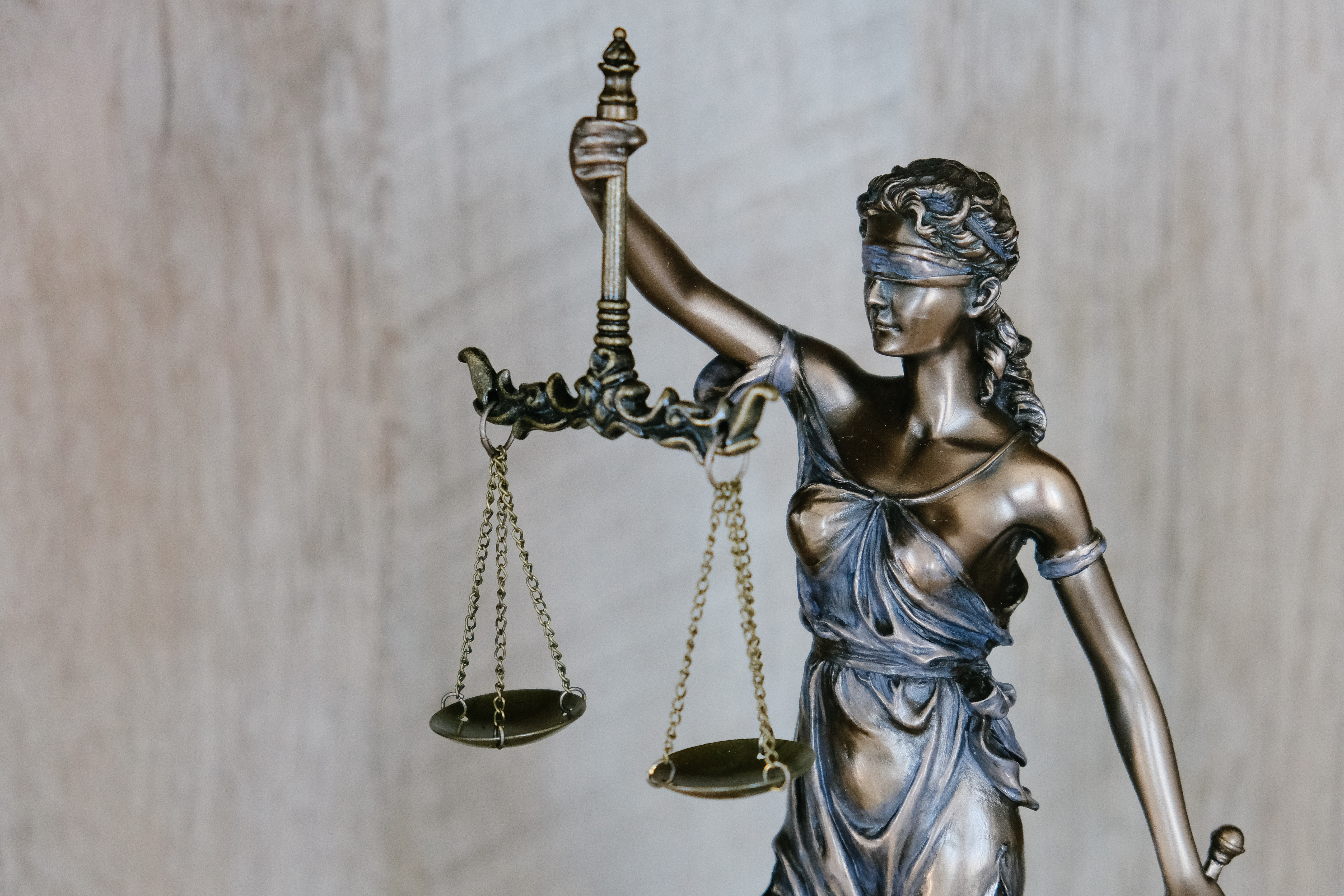 statute of a woman holding scales