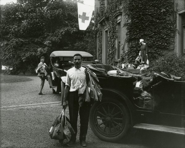Loading automobiles with Red Cross comfort bags