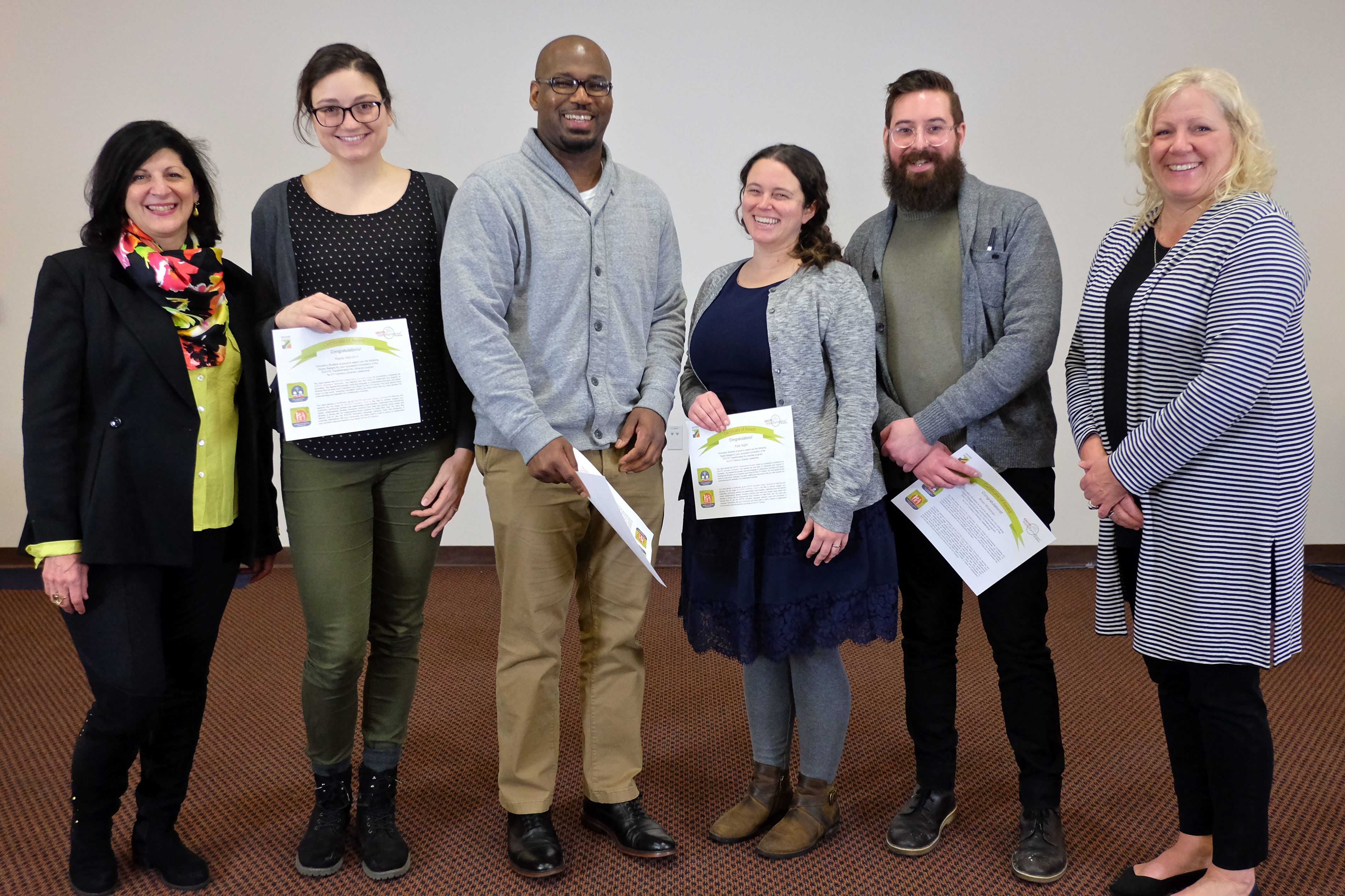 four team members from Baltimore County Public Library