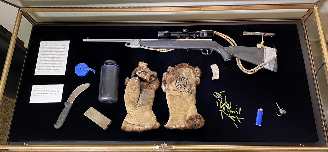 A case displaying the artist's hunting supplies