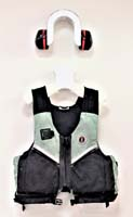 A display showing the artist's personal hearing protection and life jacket
